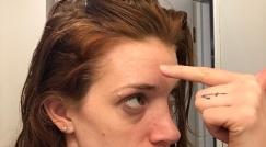 Putting aquaphor on my forehead